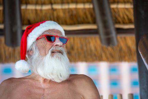 Photo of Man Wearing Santa Hat and Red Sunglasses