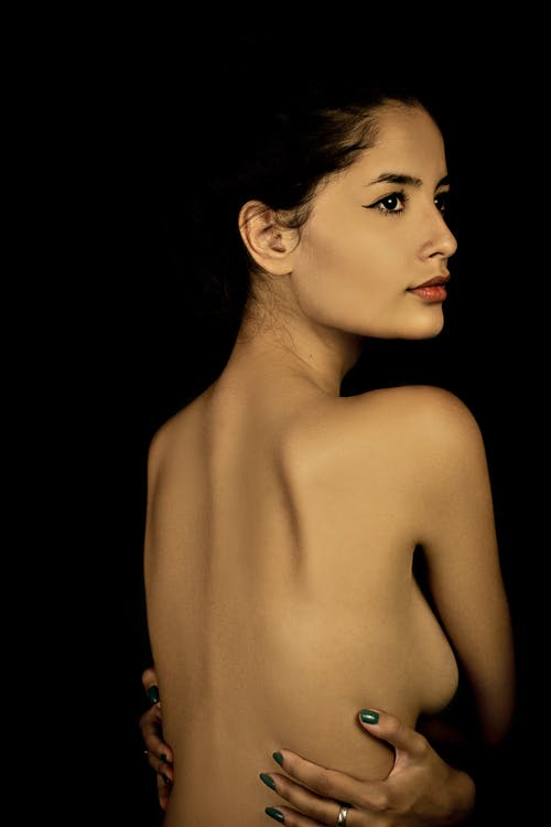 Topless Woman With Black Background