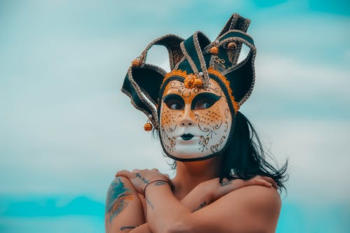 Photo of Topless Person Wearing Mask