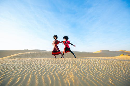 Two Person Dancing on Desert