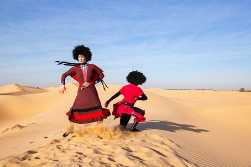 Photo of Two Person Dancing on Desert