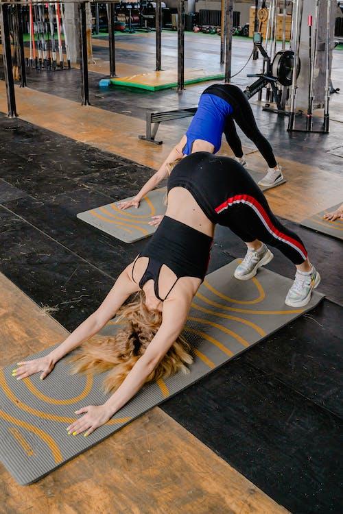 Photo of Women Bending Their Bodies