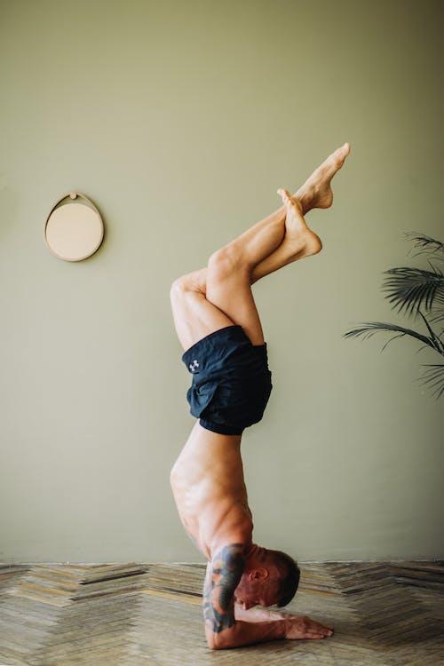 Photo of Man Doing Yoga