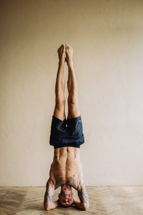 Photo of Man Doing Head Stand