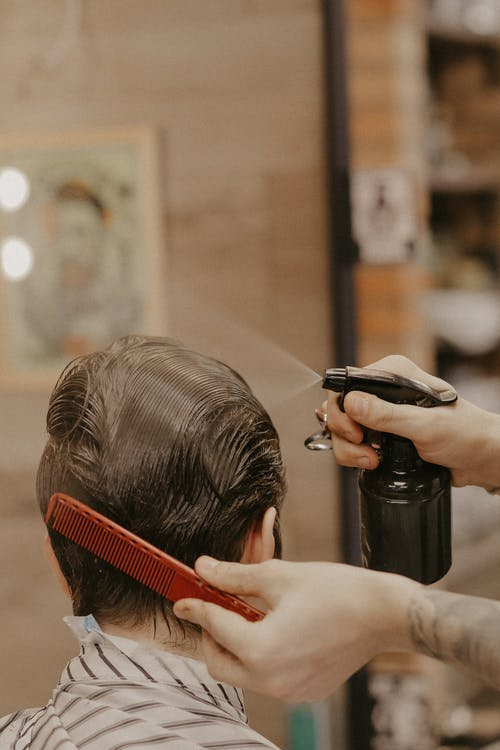 Photo of Person Getting His Haircut