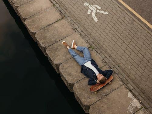 Photo of Man Lying on Concrete Floor