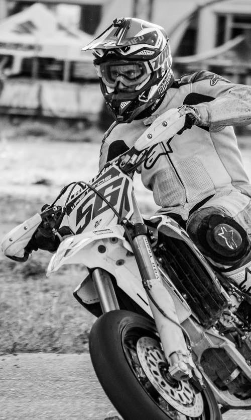Grayscale Photo of Person Riding Motorcycle