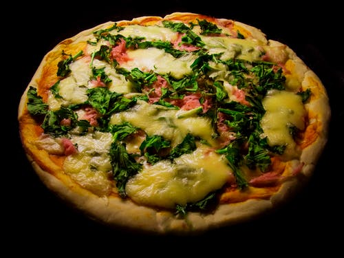 Pizza With Green Leaf Vegetable