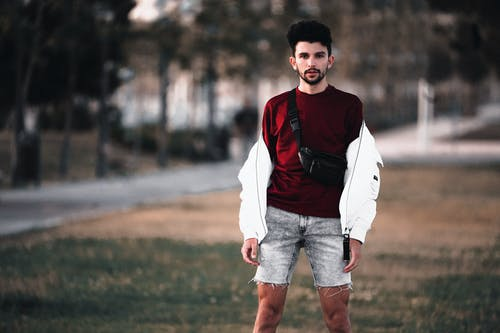 Shallow Focus Photo of Man in Red Shirt and Shorts