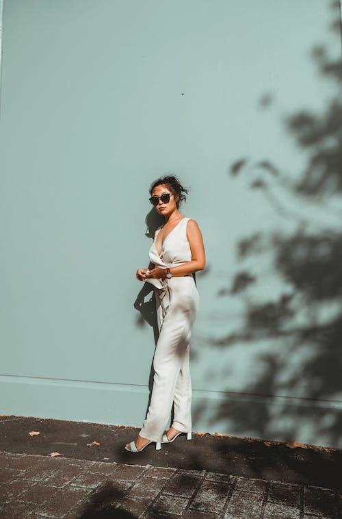 Photo Of Woman Wearing White Pants