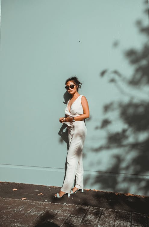 Photo Of Woman Wearing White Pants
