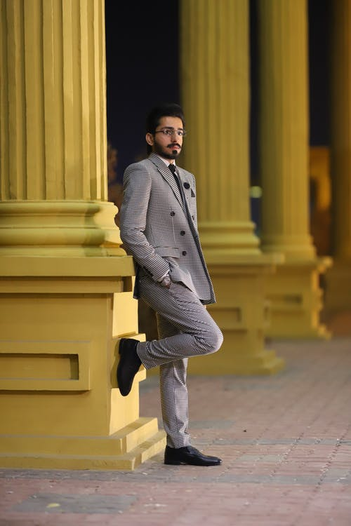 Photo Of Man Wearing Gray Suit