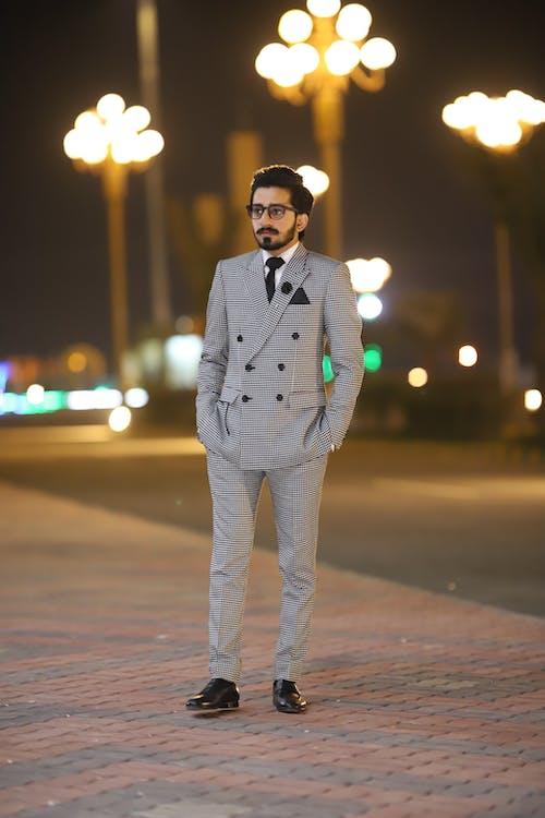 Photo Of Man Wearing Grey Suit