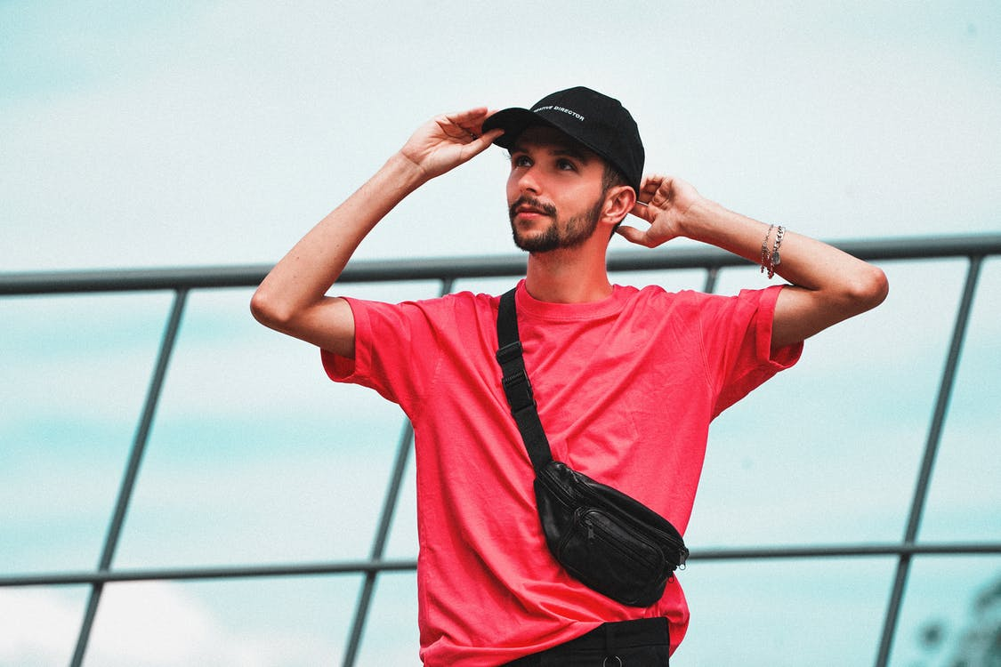 Man in Pink Crew Neck T-shirt Wearing Black Cap