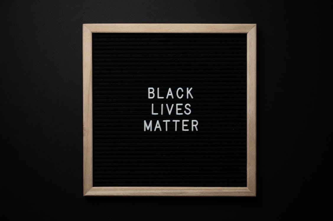 Slogan Black Lives Matter on black board