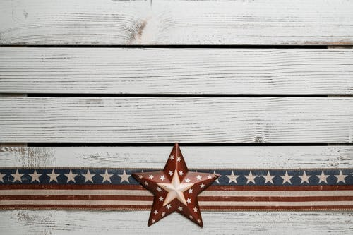 Photo Of American Flag On Top Of Wooden Surface