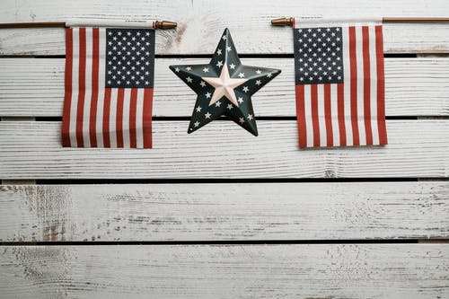 American Flags on White Wooden Wall
