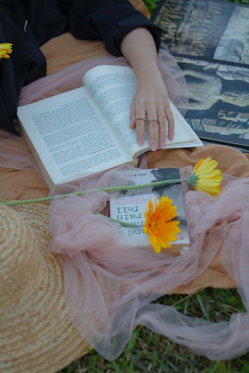 Photo Of Book Beside Flower