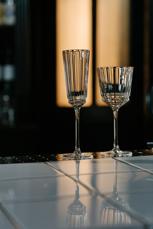 Three Clear Wine Glasses on Table