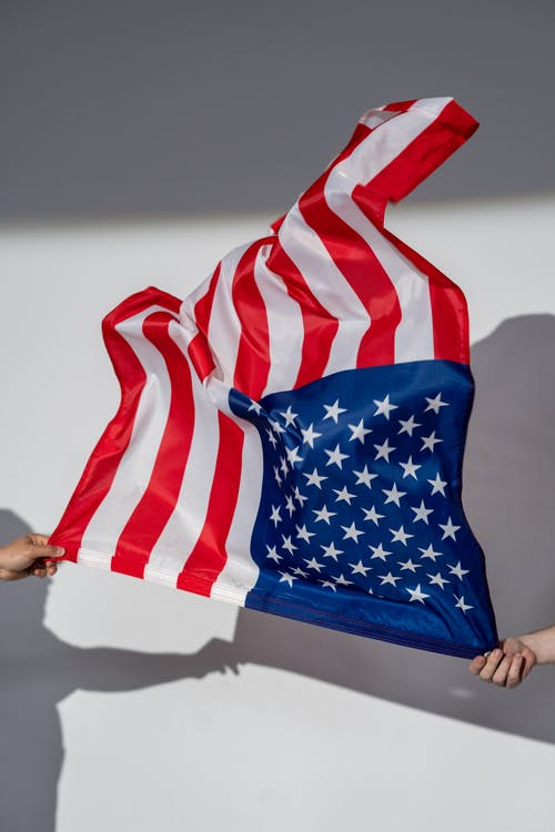 Hands Holding an American Flag