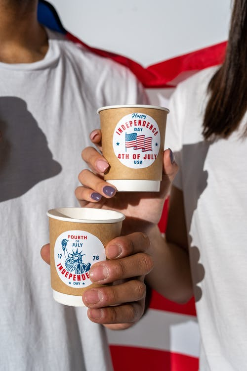 People Holding Independence Day Paper Cups