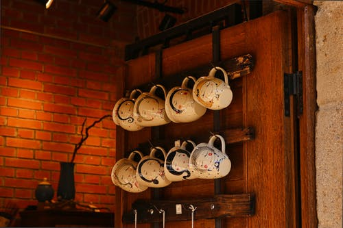 Photo Of Mugs Hanging On Wall