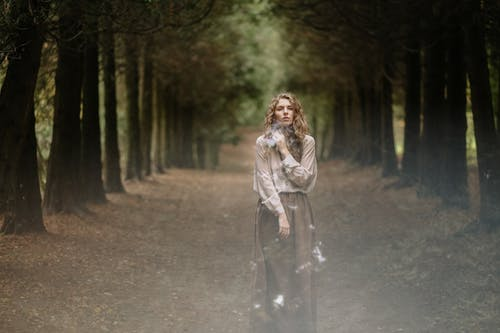 Photo Of Woman Standing In Middle Of Forest