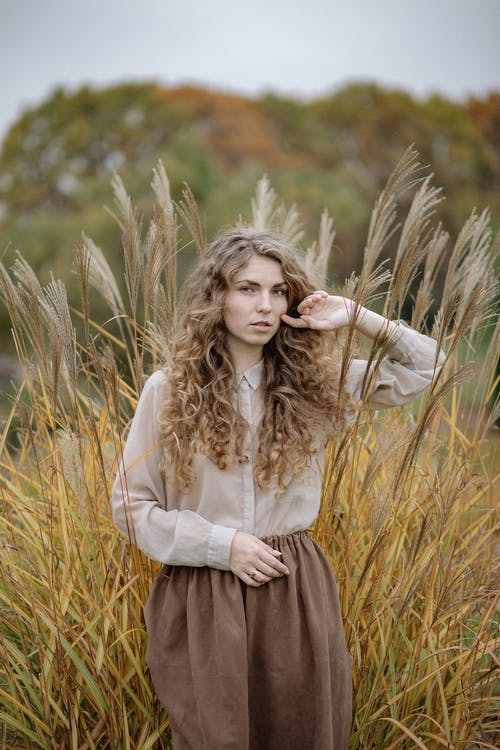 Photo Of Woman Standing Beside Wheat Leaves