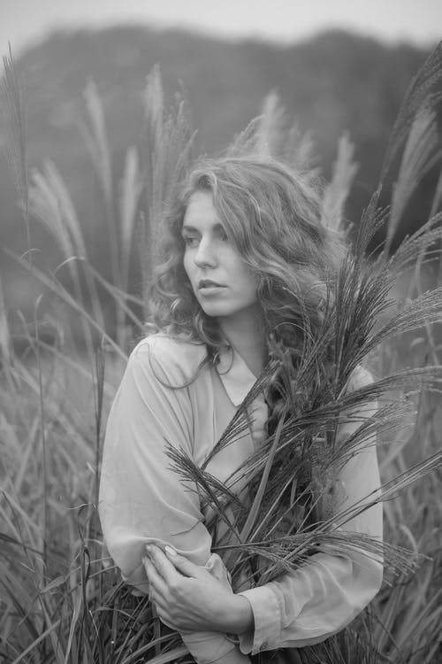 Monochrome Of Woman Standing On Wheat Fields