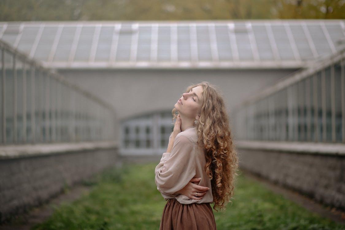 Photo Of Woman Wearing Beige Long Sleeves