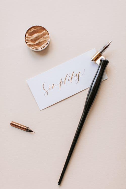 Photo Of Black Pen On Paper