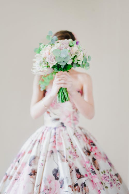 Photo Of Person Holding Bouquet