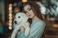 Photo Of Woman Carrying Dogs