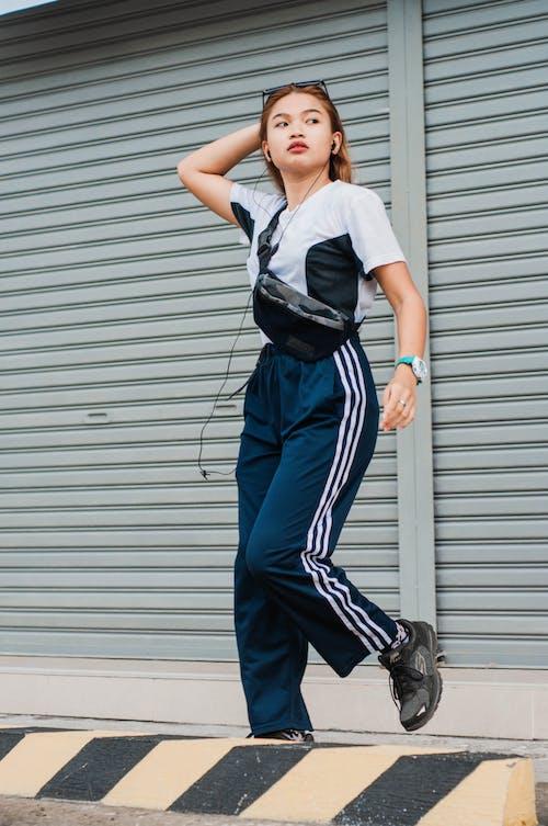 Photo Of Woman Wearing Blue Jogging Pants