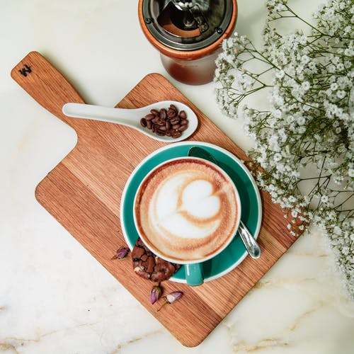 Photo Of Coffee Mug On Top Of Wooden Chopping Board