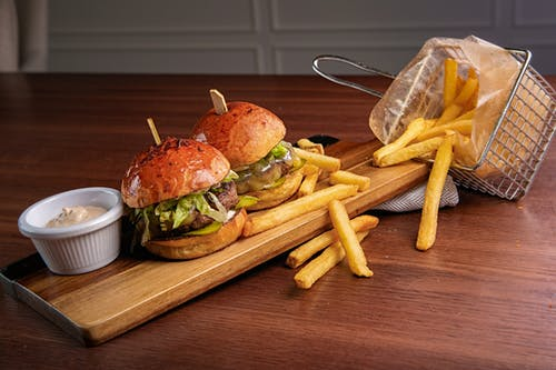 Photo Of Hamburger And Fries On Wooden Chopping Board