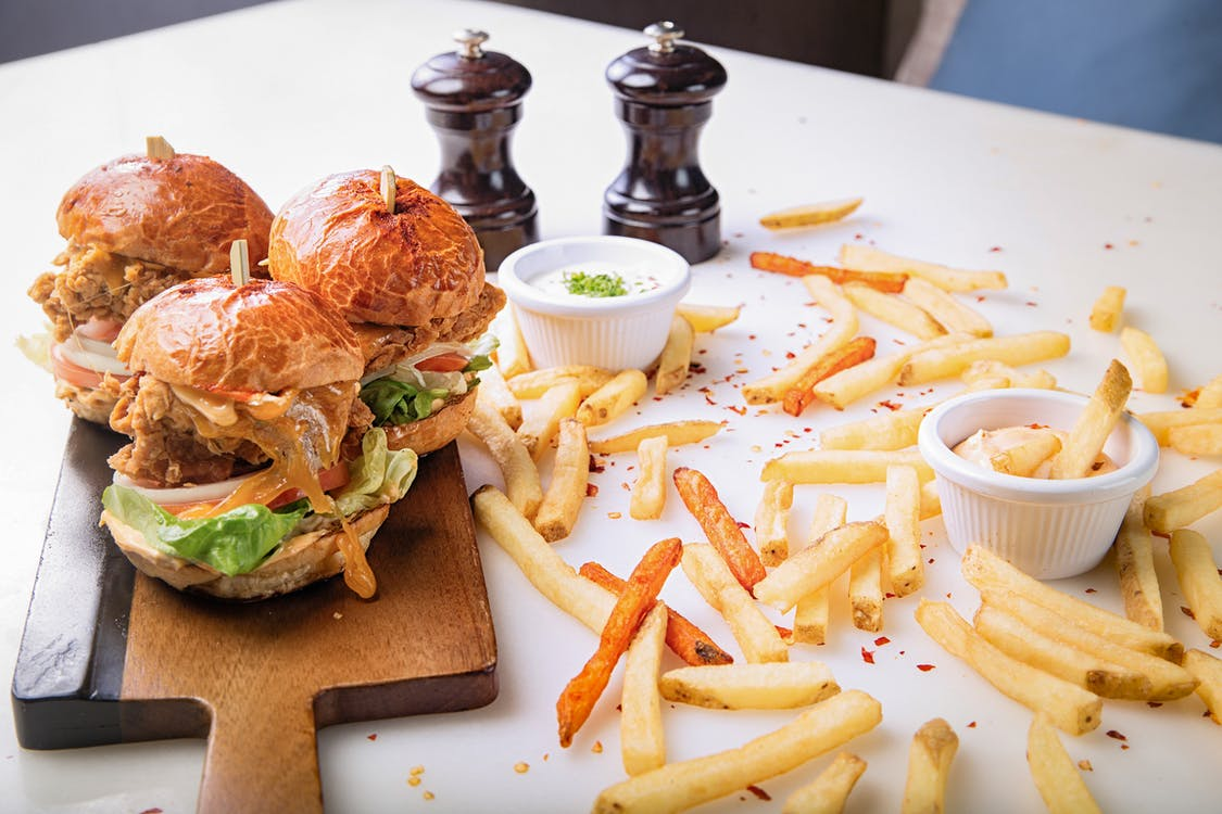 Photo Of Burgers On Top Of Wooden Chopping Board