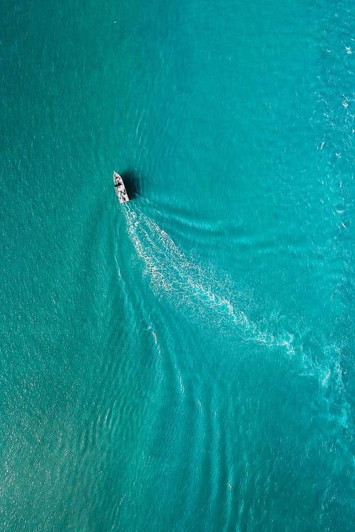 Drone view of yacht sailing in sea water