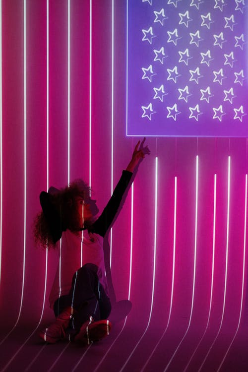 Woman in Front of a Projection of the American Flag