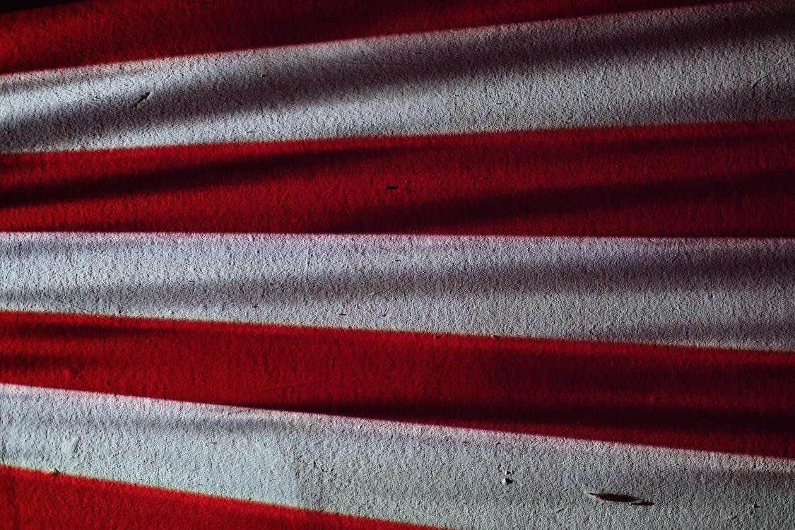 Red and Gray Striped Textile