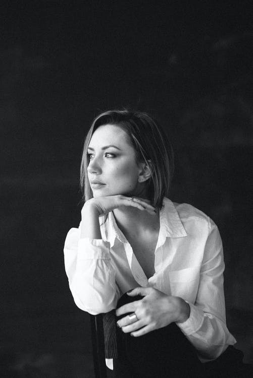 Grayscale Photo of Woman in White Blazer