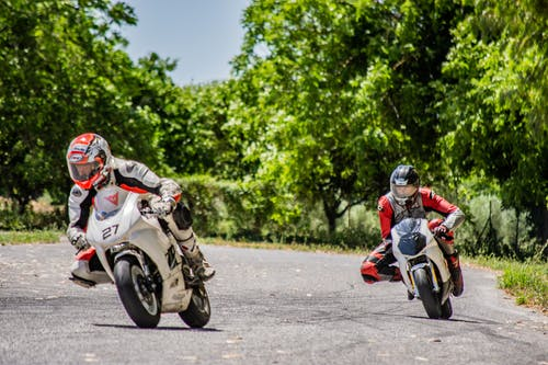 Men Racing On Motorbikes