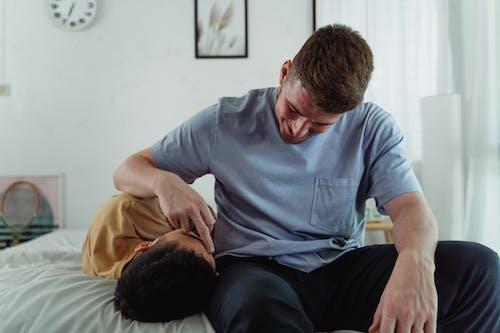 Man Caressing Another Man