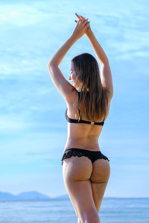 Woman in Black and White Bikini Bottom