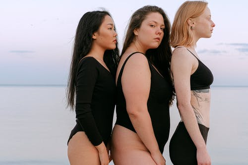 2 Women in Black Tank Top Posing for Photo