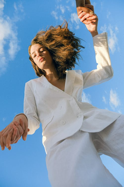 Woman in White Blazer Under Blue Sky
