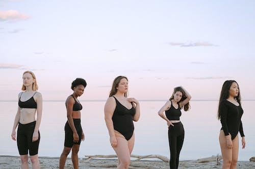 2 Women in Black Swimsuit Standing on Beach