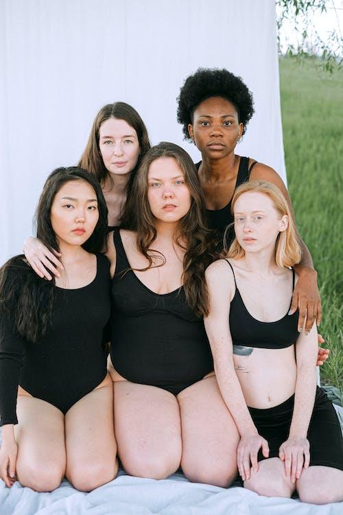 3 Women in Black Tank Top Posing for Photo