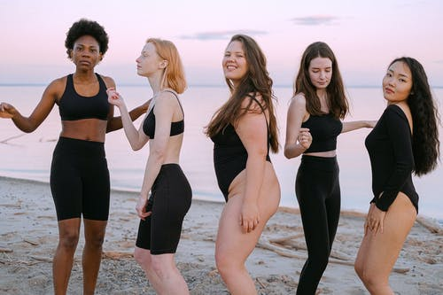 Group of Women Standing on a Beachside