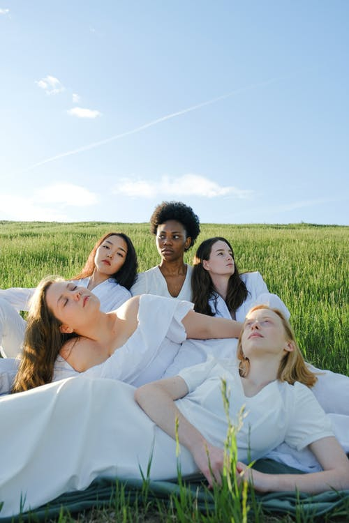 Photo Of Women Sitting On Grass